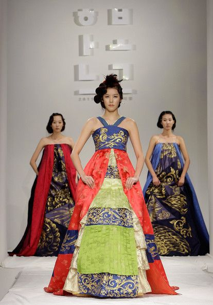 "Models walk down the catwalk during the South Korean Traditional Costume 'HanBok' fashion show on October 21, 2011 in Seoul, South Korea. Hanbok is the traditional Korean dress. It is often characterized by vibrant colors and simple lines without pockets. Although the term literally means ""Korean clothing"", hanbok today often refers specifically to hanbok of Joseon Dynasty and is worn as semi-formal or formal wear during traditional festivals and celebrations."