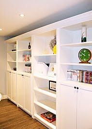 IKEA hack- billy bookcase (Really like the storage units on the bottom)  Basemen…