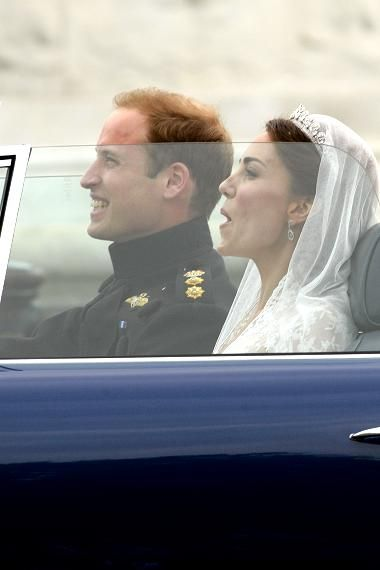 """Prince William (William Arthur Philip Louis) (1982-living2013) of Wales, UK & wife """"Kate"""" (Catherine Elizabeth Middleton) (1982-Living2013) UK after their 2011 wedding. William borrowed his father's (Prince Charles (1948-living2013) UK) car, an Aston Martin,  decorated for his wedding by his brother Prince Harry (1984-living2013) of Wales, UK."""