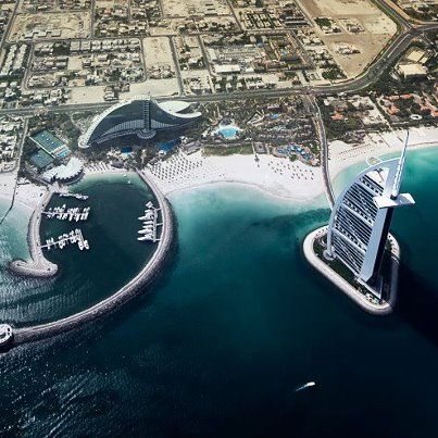 Dubai - get a group of friends together and take a helicopter to the hotel's landing pad, on the very top of the hotel. Then, rent a few lux cars to tool around the city. Cost savings? Put as many people in the cheapest room available, like Spring Break in college. You're never in your room anyway!