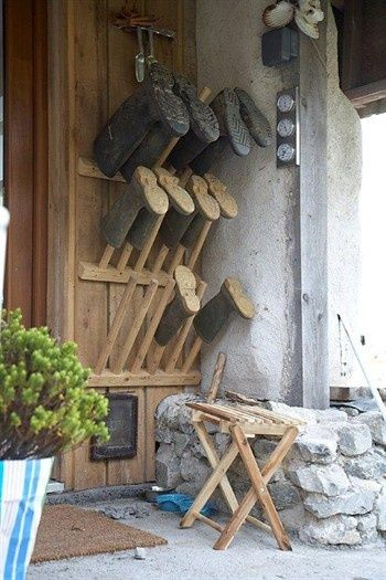 Chu/AntiChaos! Boot stands Outside!, bitty bench, tools+gloves, barometer, pet door, bet there's a hatrack just out of sight...all collected coming or going! Marvelous.