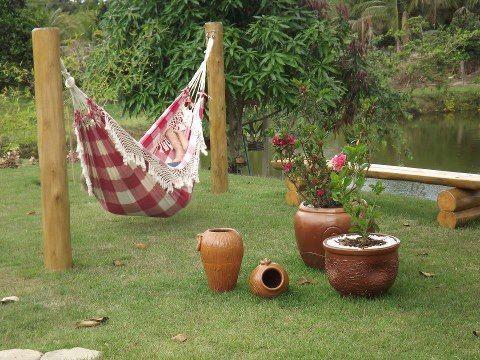 Ideas para el jardin amazing unos muebles de jardn super - Como instalar una hamaca en la pared ...