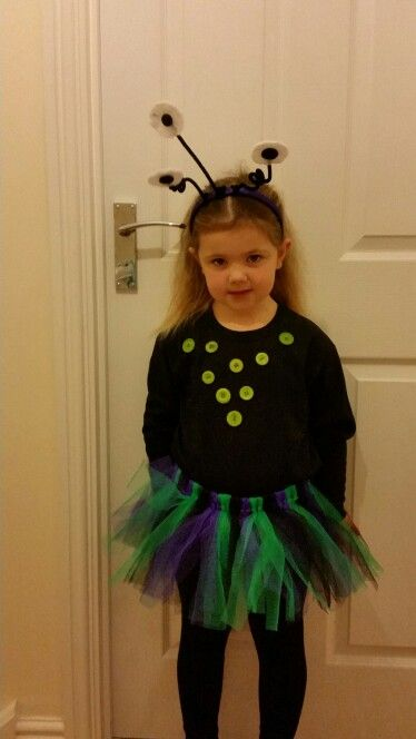 Alien costume for alien day at school. Easy to make tutu, buttons on a black top and eyes on a head band - quick and easy costume
