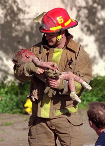 Oklahoma City firefighter Chris Fields carries a dying Baylee Almon   away from the rubble. She had celebrated her first birthday  just one day earlier.     Charles Porter's photo was widely distributed by The Daily Oklahoman   and the Associated Press and quickly became recognized around the world.    The photo earned the 1996 Pulitzer Prize for Spot News Photography. OKC was my home from the time I was born until 1996. The bombing will always haunt me.