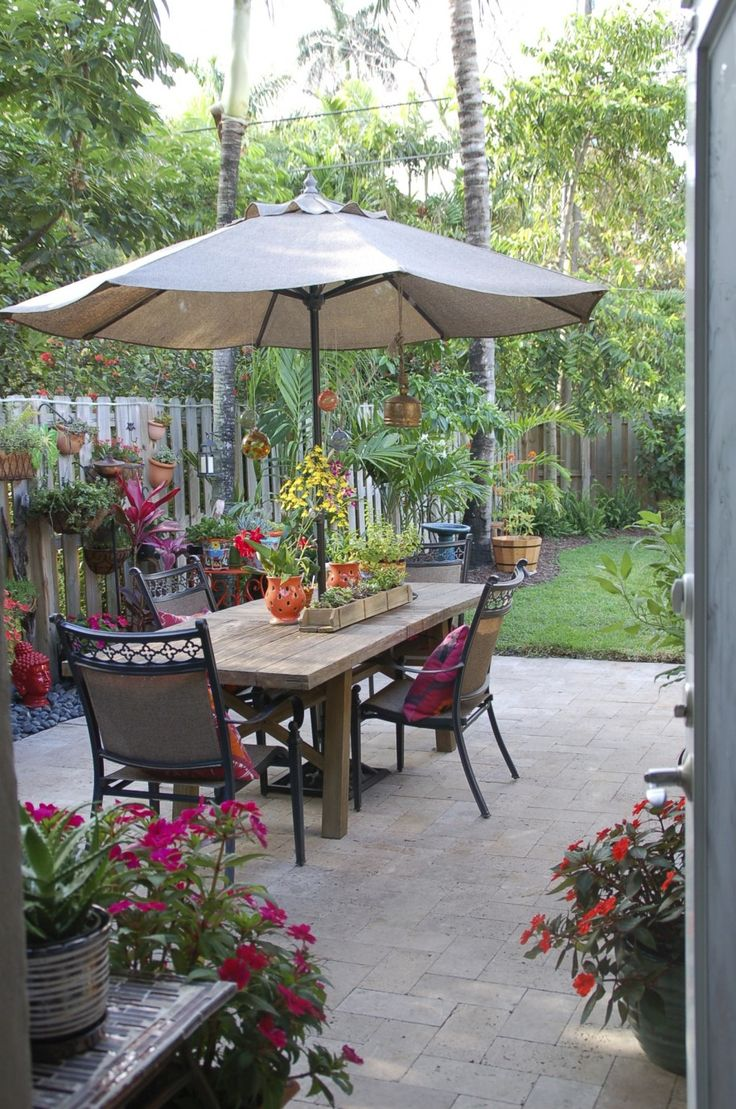 Awesome Various Patio Garden Ideas : Alluring Slate Patio With Outdoor Furniture Rustic Table And Chair Garden Umbrella Also Beautiful Coloring Flowers In Backyard Gardens Landscaping