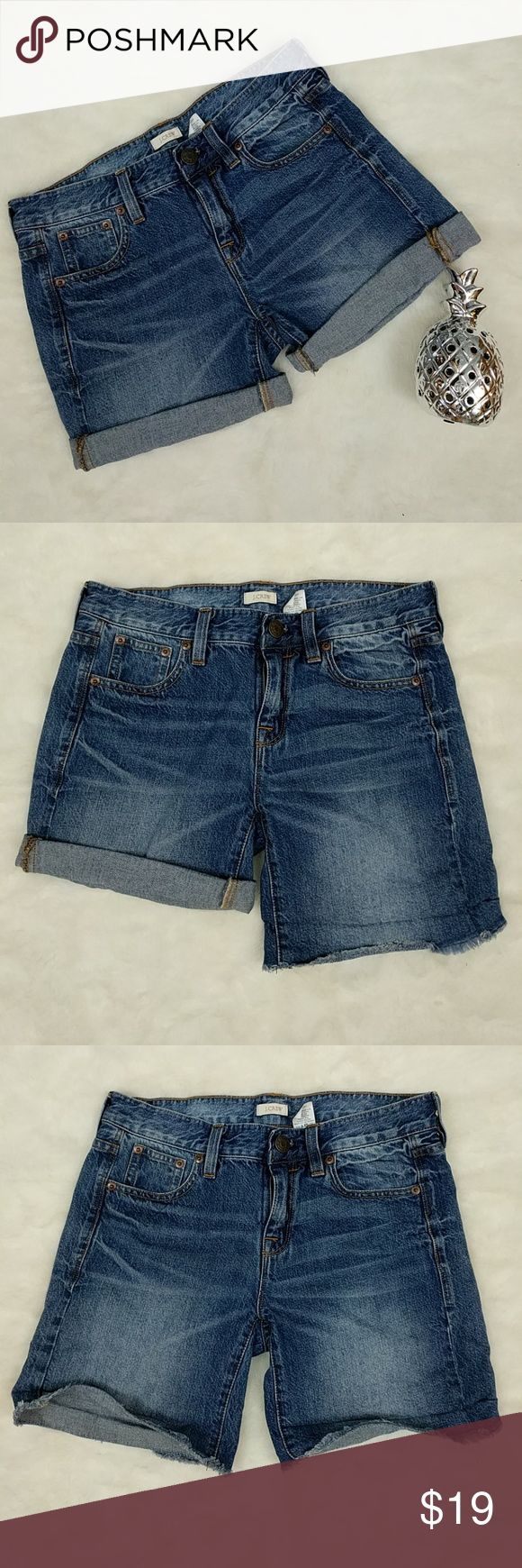 "J. Crew Cut Off Jean Shorts Medium blue wash and stressed jean shorts from J. Crew. Shorts have frayed appearance, but are sewn to prevent further fraying. Shorts are easily rolled up. Laying flat, and unrolled, shorts measure approximately 16"" across waist, 8"" rise, and 7"" inseam. J. Crew Shorts Jean Shorts"