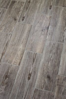 Bathroom tile that resembles old wood. Tile Shop. Item 682216 Bayur Borneo - Grout color is 052000 - Natural Sanded.