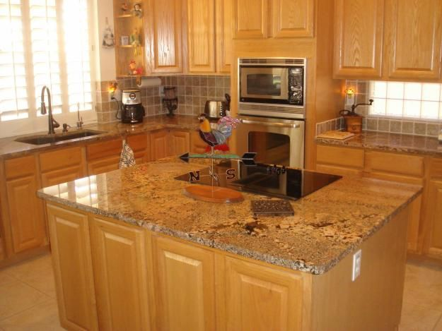 this color granite works with oak cabinets and light floors