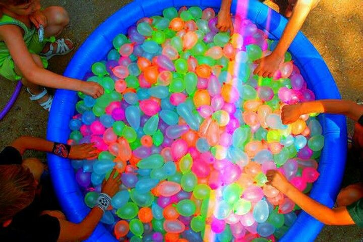 Fill a tub with balloons full of washable paint, DOING THIS
