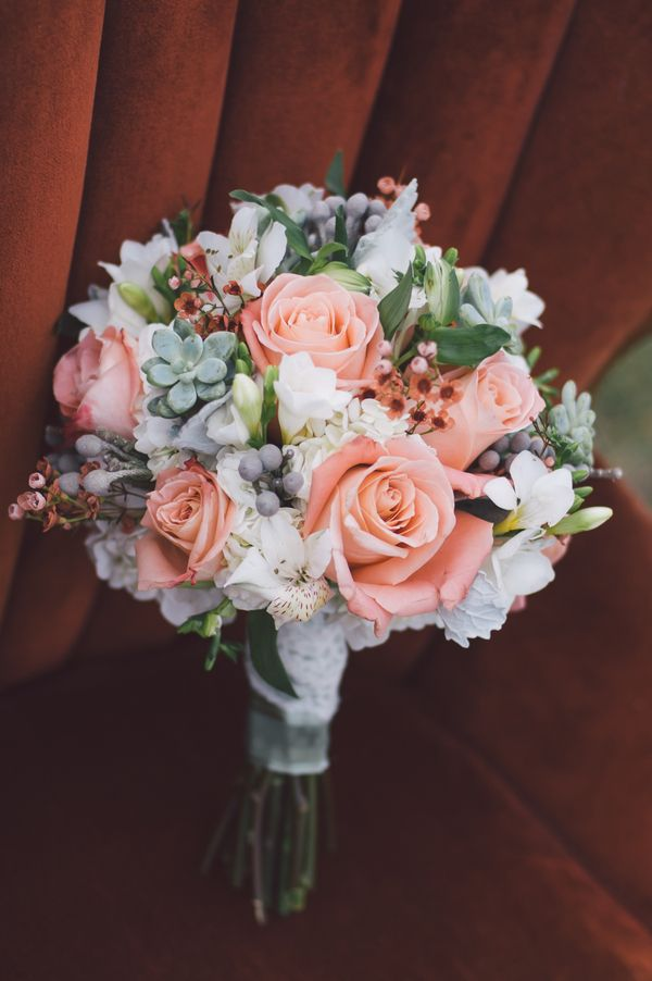 The bridal bouquet embodied the wedding color scheme of light gray, pale green, and pink. | Photo by Kristilee Parish Photography, Floral Design by The Flower Pot