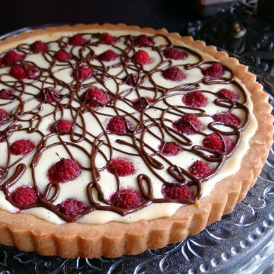 White Chocolate Cream Cheese Raspberry Tart. This dessert is sure to please everyone.