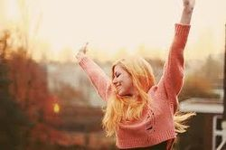 This shows exhilaration because the girl is throwing her arms in the air with joy.