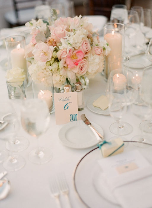 Coral and Dragonfly (teal) table numbers, place cards, escort cards, and favor tags on #stylemepretty by #nozza