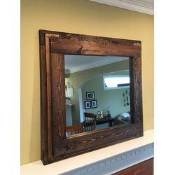This large rustic mirror is hand crafted from solid wood. The frame's construction features a three tier design of natural wood making the frame a total of 5.5 inches wide. The frame is hand stained and protected with a rubbed layer of eco-friendly wax. The light distress adds the character of a vintage piece. The large size is perfect for a mantle display or to hang on the wall. Hanging hardware is installed for both vertical and horizontal hanging.