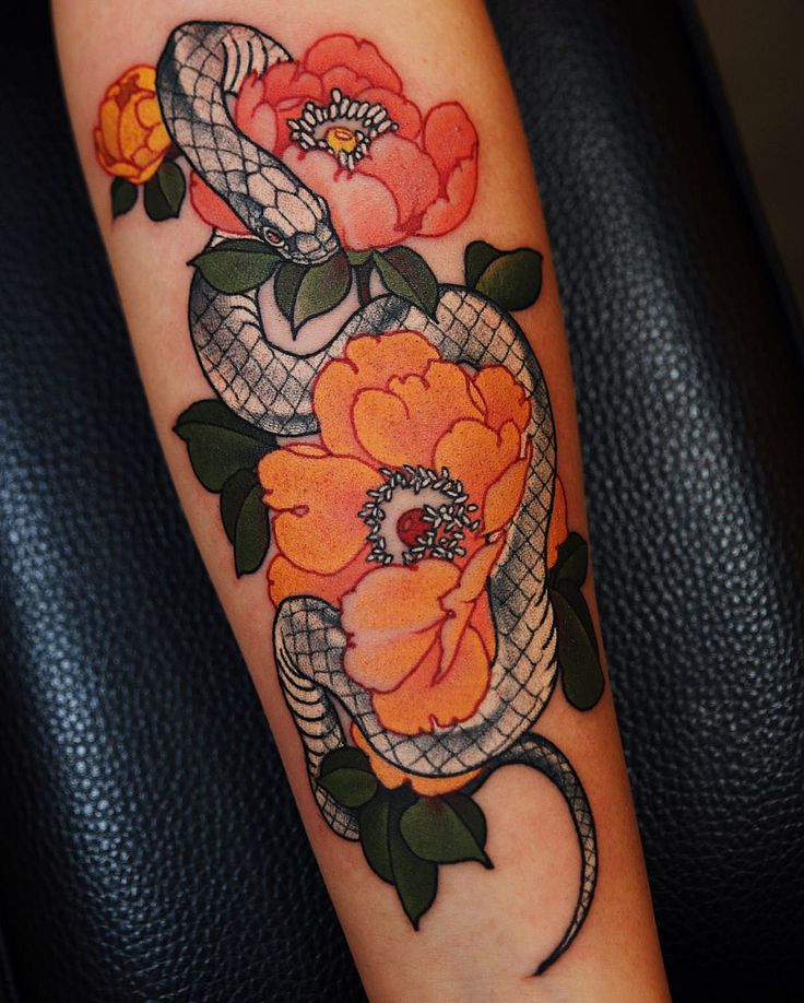 My first tattoo (white snake & peonies) by Jinpil Yuu at Ravens Ink in Seoul Kor…