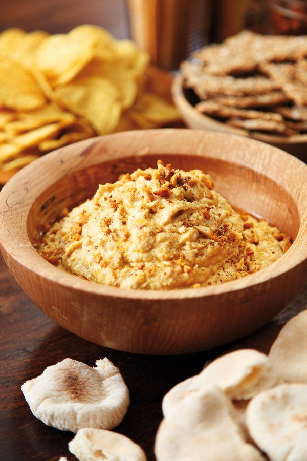 Peanut Butter Hummus  (Nigella)  ------ 2 tspns sea salt flakes (or 1 tspn salt) , 2 tspns ground cumin , 5 tblspns greek yoghurt. Serve :  2 tblspns peanuts (finely chopped) & 1 tspn smoked paprika - - - -  Drain &  rinse chickpeas. Put garlic clove, chickpeas, 3 tblspns oil, peanut butter, lemon juice, salt & cumin in food processor & blitz to a knobbly purée.  Add 4 tblspns  Greek yogurt & process again. If hummus is still very thick add another 1–2 tblspns yogurt & same of oil.