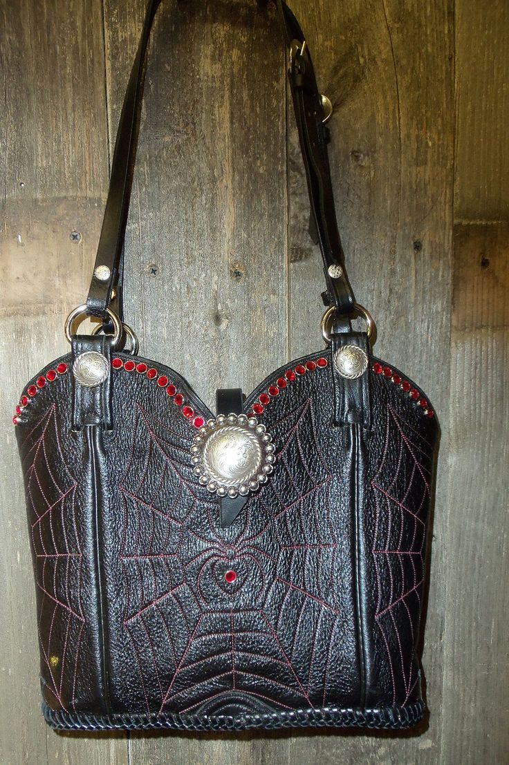 First pair of boots I've seen with a spider web and spider! Specially made for Holly Johnson! #recycle #cowboyboots #cowboybootpurse #madeinusa http://www.diamond57.com/cowboybootpurses