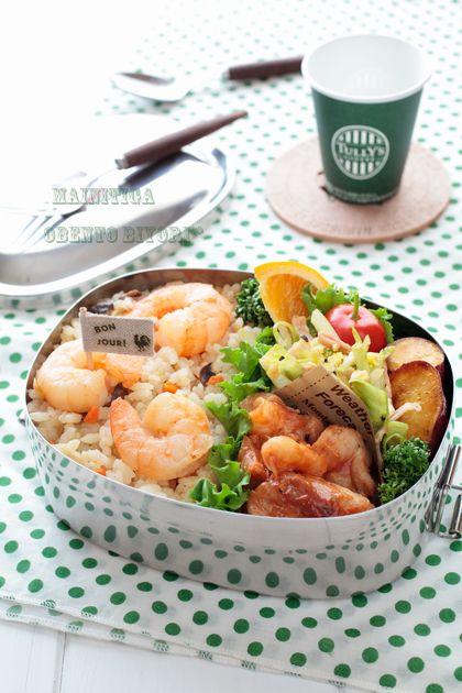 Shrimp pilaf, sauteed pork, potato, bacon and cabbage, orange, and cherry tomato.