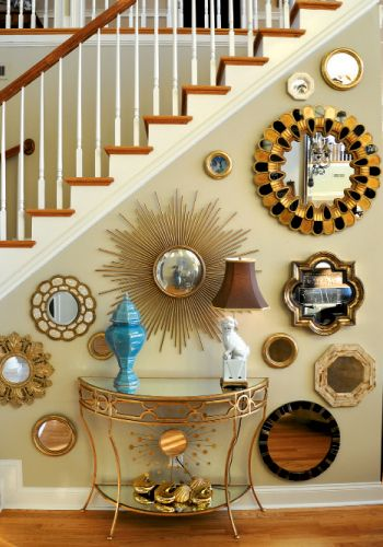 Love this take on a gallery wall.  Oh, and I NEED that morrocan style mirror on the right.