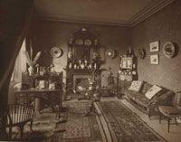 A late Victorian drawing room interior with wall sconces from Robert Hammond's book, 'The Electric Light in Hour Homes', 1884. IET Library and Archives collection.