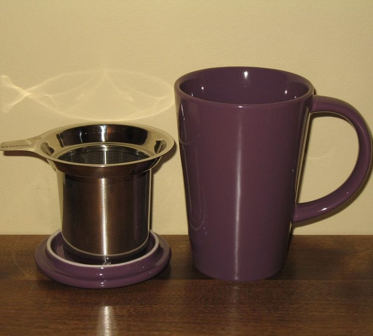 Handsome purple tea mug from DavidsTea. Ceramic with a stainless steel tea infuser and a lid. The lid can be used as a coaster for the infuser when you remove it from your tea. Clever idea.