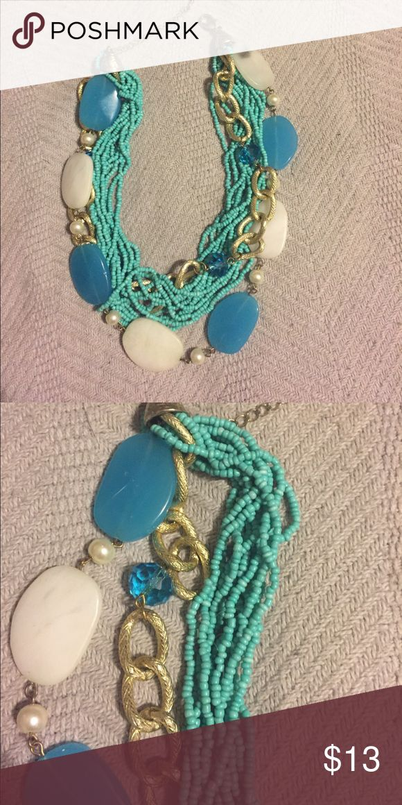 Multi stranded turquoise,gold,white necklace Very cute multi stranded necklace with pearl accents large blue and white beans gold accent chain and turquoise beads Jewelry Necklaces