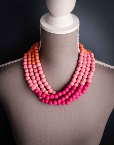 This Orange and Pink Ombre Necklace is a multi strand wooden necklace in shades of orange and pink – more specifically coral, light pink and fushia. Shop @ www.wave2africa.com