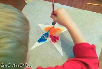 Painting stars w/corn syrup and food coloring.  Outer space program craft?