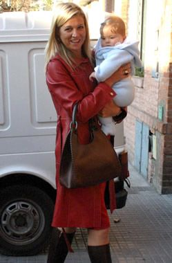 Crown Princess Maxima cuddles her seven-month-old daughter, Princess Catharina-Amalia, on a day out in Buenos Aires.