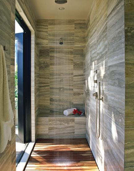 Luxurious amount of space, huge window, grey vein cut marble and slatted teak floors