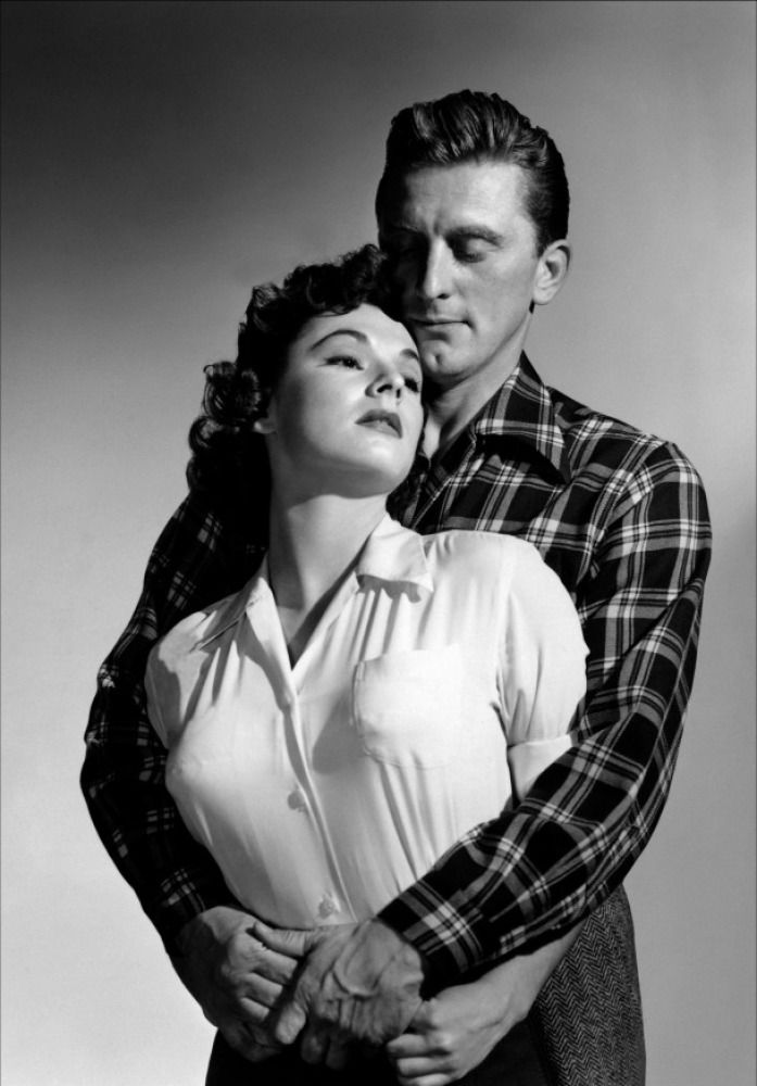 """Kirk Douglas and Ruth Roman in a promotional still for """"Champion"""" (1949)"""