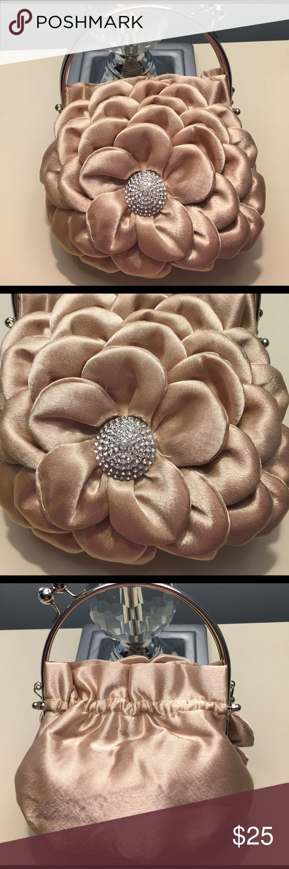 Gold, Flower, Crystal Embellished Clutch. Worn 1X This is a gold evening clutch. It features a flower design with a crystal embellished center. It is pretty roomy for a  evening clutch. It also has a long strap so you can wear the bag on your shoulder. In excellent used condition. Worn one time for my rehearsal dinner. Offers welcome. Bags Clutches & Wristlets