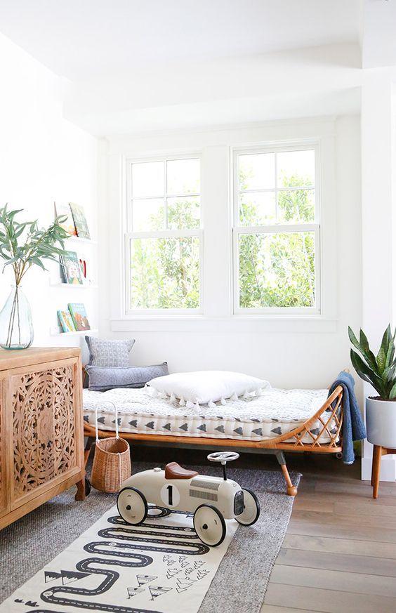 kids room, grey rug, rattan bed frame, grey wood floor, white walls