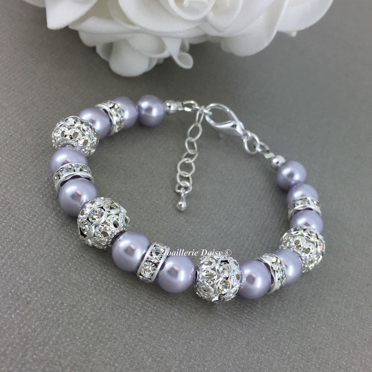 Swarovski Lavender Pearl Bracelet Lavender Bracelet Bridesmaid Bracelet Bridesmaid Gift on a budget Purple Pearl Bracelet Bridal Party by dcjoaillerie on Etsy https://www.etsy.com/ca/listing/490908618/swarovski-lavender-pearl-bracelet