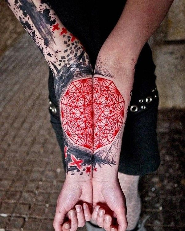 Abstract watercolor tattoos on full arms for woman