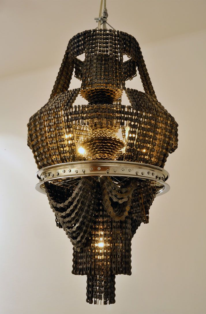 Recycled Bicycle Chandeliers by Carolina Fontoura Alzaga | Yatzer.  Made with bicycle chains, wheels and spokes. Wow !