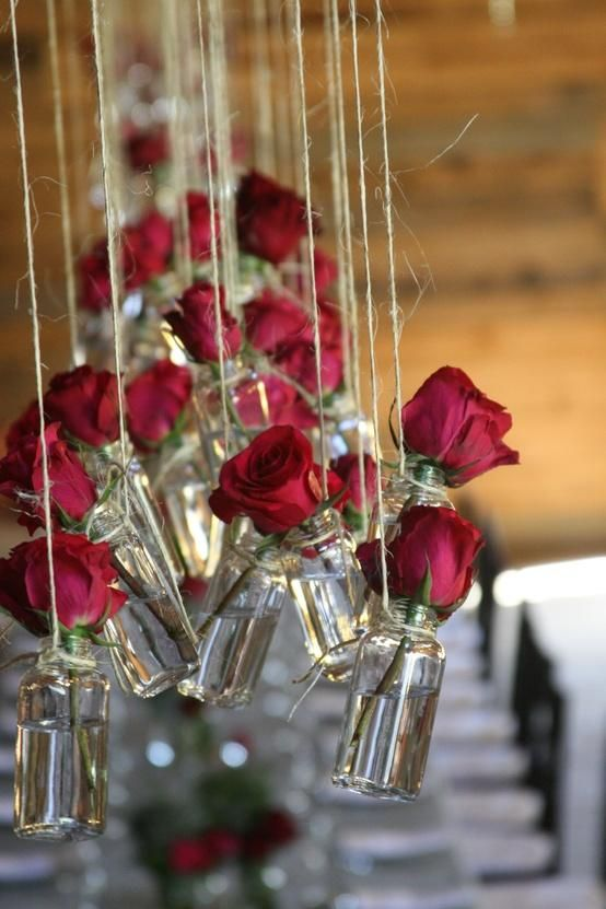 Raspberry roses hung with natural twine. Of course, these little bottles are wonderful too.