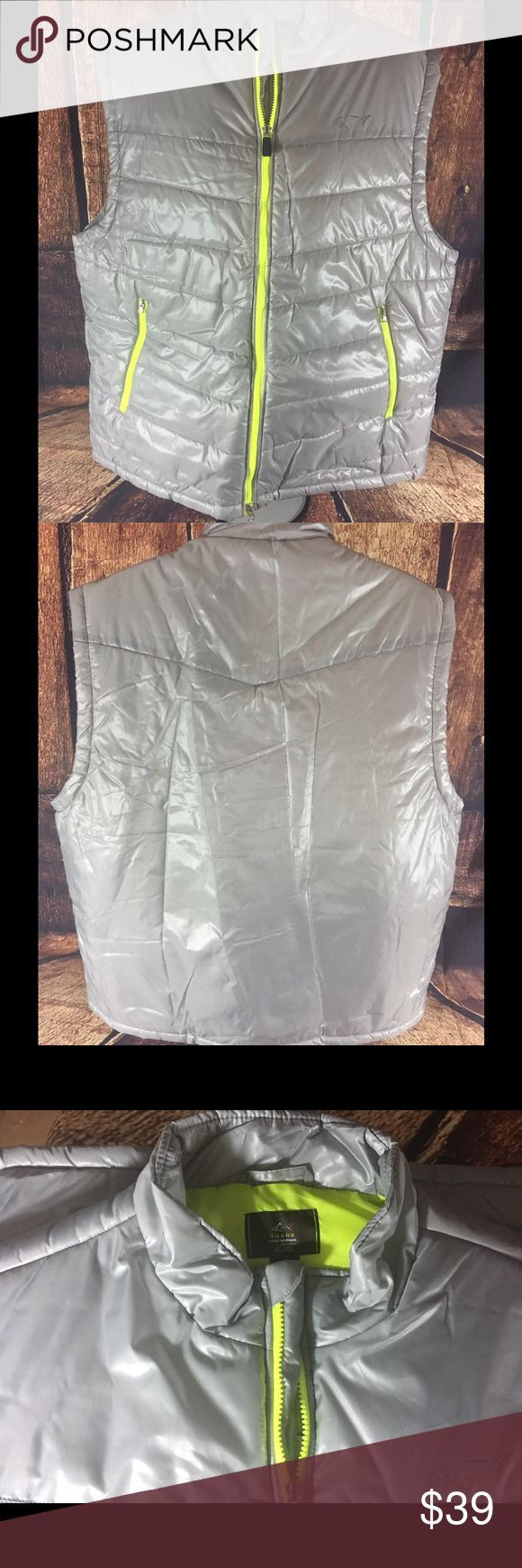 Greg Norman Golf Vest Puffer XXL Shark New This is a new with tags Greg Norman Shark puffer vest. Great for golfing or other outdoor activities. This silver vest features neon golf green trim.  In a Size 2xl. Greg Norman Shark Jackets & Coats Puffers