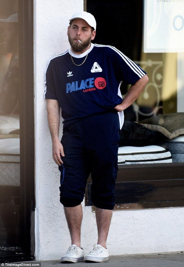 Slimming down: Jonah Hill showed off his slimmed-down frame while puffing on a cigarette in Los Angeles on Monday