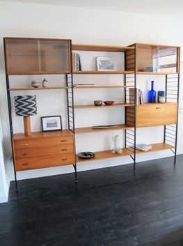 "Teak & Steel 'Ladderax' Shelving System by Ladderax, UK.  Ladderax is a modular shelving and storage system created by Robert Heal in London in 1964.  Mid-Century modern design, this was influenced by the work of the ""Danish school"" design movement which reinterpreted simple, linear shapes from Georgian and Shaker pieces."