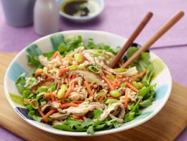 15-Minute Asian Rice Salad : This comforting salad is ready in just 15 minutes. To keep the prep time to a minimum, grate fresh ginger instead of finely chopping it, use kitchen shears instead of a knife to snip off the stems of the shiitake mushrooms, and purchase precooked brown rice, grated carrots and shelled edamame.