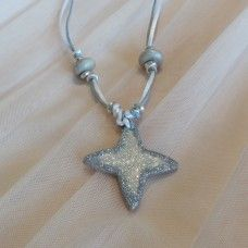 Christmas Star Pendant.  The magic of Christmas comes alive with the star that led to a baby in a manger in Bethlehem. This star is about visions, journeys, discovery, love, family and peace. Spending time with loved ones and helping others is the simple message of Jesus. Let love, faith and happiness surround you in the Christmas season. Hand crafted porcelain – made in Australia. Cord Length: 84cm or tie to desired length. $18.00au.  Pendent dimensions:   4.5cm x 4.5cm
