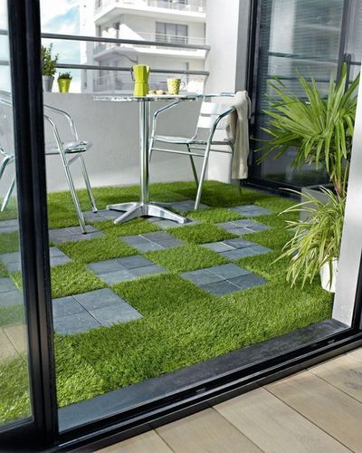 Artificial grass, ideal for balconies where it is rather tricky to grow your own…