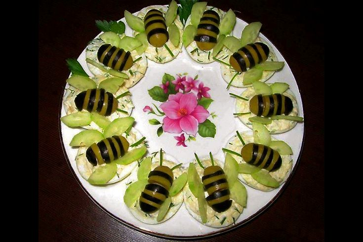 What a cool idea... Little bees made out of black and green olives and a cucumber.... Love it!