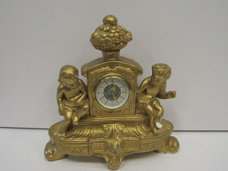 German Ceramic Mantle Clock with Putti Figures - shopgoodwill.com