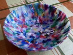 Bowl made of recycled HDPE plastic bottles and lids, ground up, melted in a sandwich maker, then formed between two steel bowls. Awesome!!! (You can also make flat sheets, and cut them!)