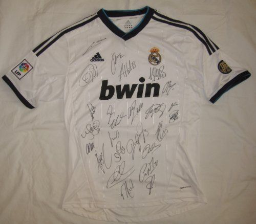 2012-13 Real Madrid Team Signed Soccer Jersey - 25 Sigs - Cristiano Ronaldo & Jose Mourinho - Autographed Soccer Jerseys by Sports Memorabilia. $647.50. Brand new Adidas soccer jersey signed by the 2012-13 Real Madrid soccer team. The jersey has been signed by 25 names including Manager Jose Mourinho, Cristiano Ronaldo, Iker Casillas, Mesut Ozil, Angel Di Maria, Pepe, Karim Benzema, Sergio Ramos, Xabi Alonso, Kaka, Michael Essien, Gonzolo Higuain, Raul Albiol, Sami Khedira, L...