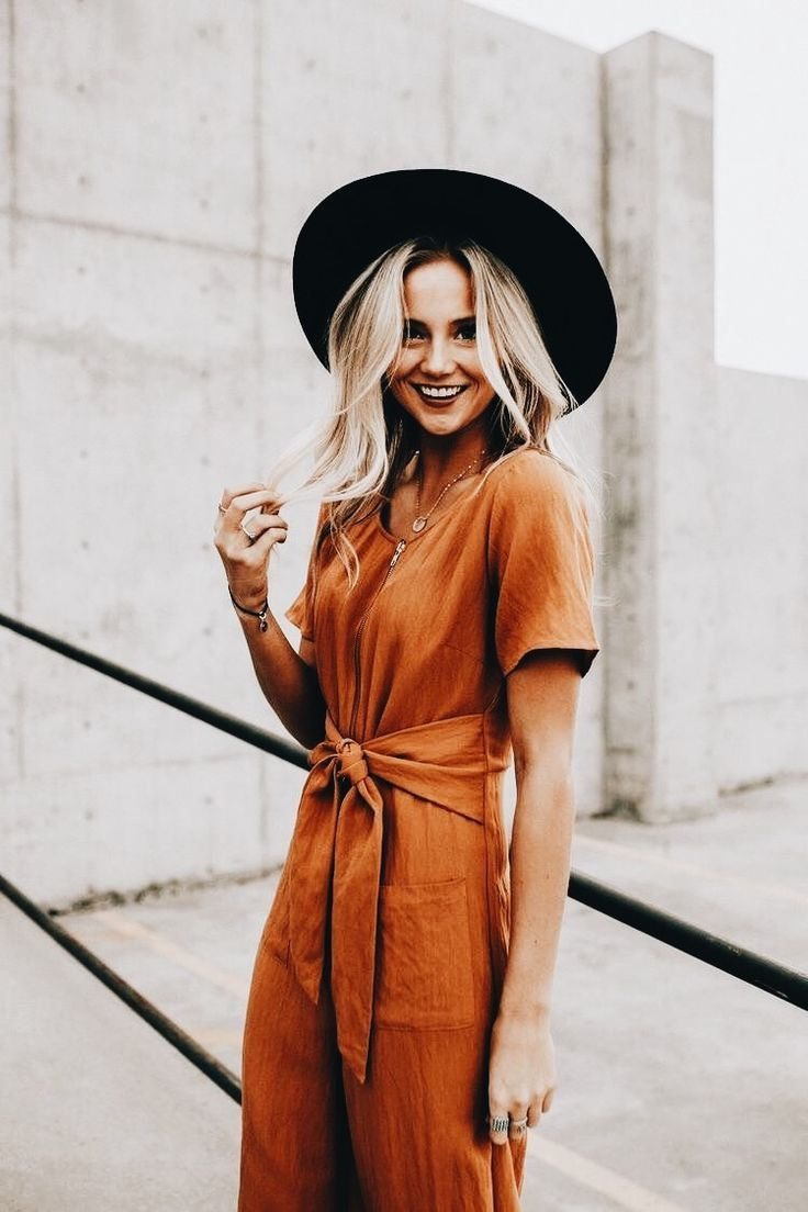 cc512b10f765 Burnt orange tied up jumpsuit romper with a wide brim black hat. so chic  and easy