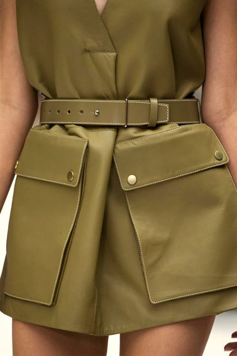 Acme Studios Spring 2015  The use of khaki coloring in a tailored style shows evidence of world war one influence. This color has become especially popular ever since the US began wearing khaki uniforms. The influence is still going strong to this day.