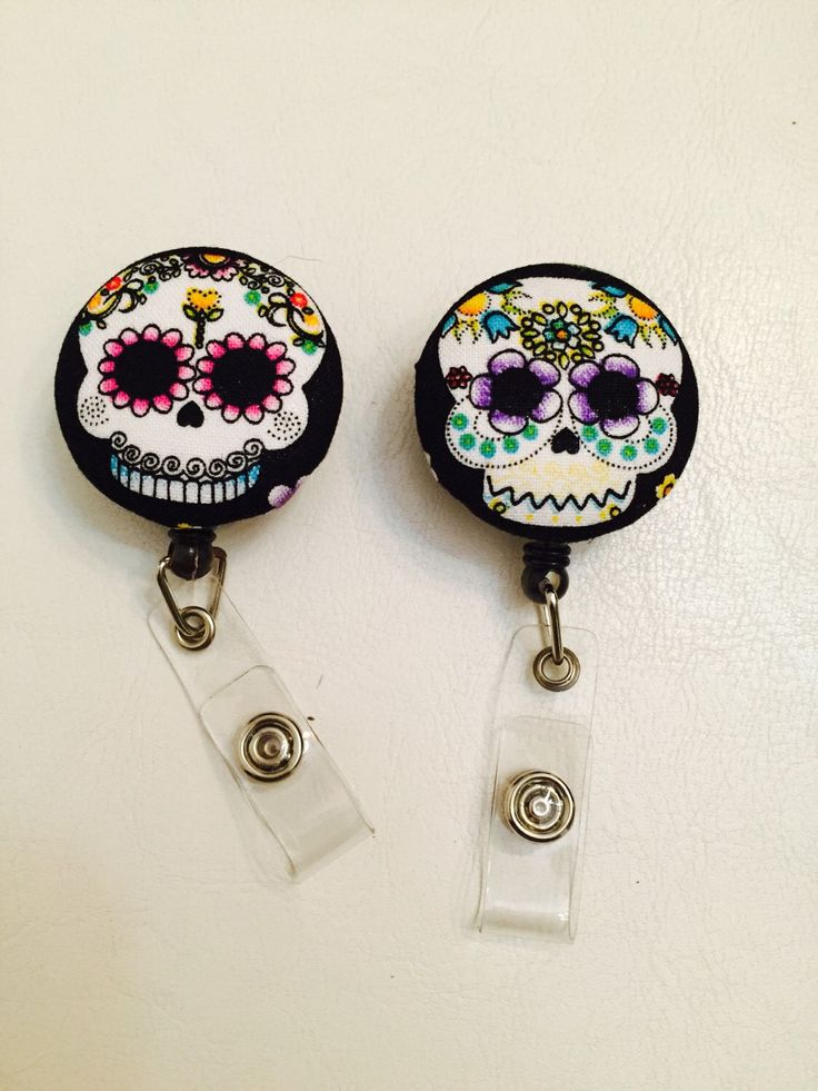 Sugar Skull Reel Id Badge Holder by CassiopeiAccessories on Etsy https://www.etsy.com/listing/265547333/sugar-skull-reel-id-badge-holder